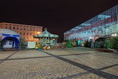 Christmas market on Sophia Square in Kyiv, Ukraine. Area for children`s entertainment. Carousel with fairy-tale heroes. Early morning view Royalty Free Stock Photo