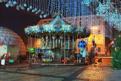 Christmas market on Sophia Square in Kyiv, Ukraine. Area for children`s entertainment. Carousel with fairy-tale heroes. Close up photo. Early morning view Stock Images