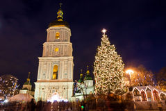 Christmas market on Sophia Square in Kyiv, Ukraine. Main Kyiv's New Year tree and Saint Sophia Cathedral on the background Royalty Free Stock Image