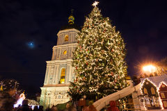 Christmas market on Sophia Square in Kyiv, Ukraine. Main Kyiv's New Year tree and Saint Sophia Cathedral on the background Royalty Free Stock Photo
