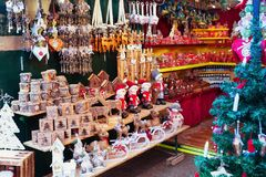 European Christmas market stall with different gifts. Christmas market stall with gifts and souvenirs for sale Royalty Free Stock Images