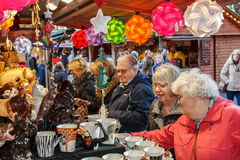 Christmas market stall - Manchester,UK. Manchester,England - November 16th 2015:Manchester Christmas market stall busy with senior male and female visitors Stock Photos