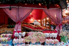 Christmas market stand with candies and lollipops stock images