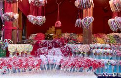 Christmas market stand with candies and lollipops stock photography