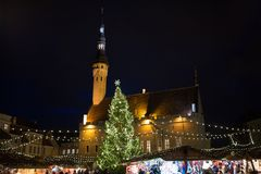 Christmas market at tallinn old town hall square. Holidays, sale and retail concept - evening christmas market at old town hall square in tallinn Stock Photo