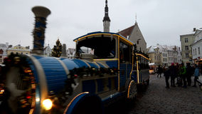 Christmas market in Tallinn, skating children on a small train. Skating children on a small train on Christmas holidays in Tallinn stock footage