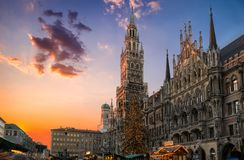 Christmas market and tree at the Marienplatz in Munich, Germany. During sunset stock photography