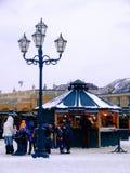 Christmas market in Vienna. People drinking glühwein Stock Image