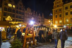 Christmas market in Wroclaw, Poland. WROCLAW, POLAND - DEC 7, 2017: Christmas market on Market square Rynek in Wroclaw, Poland. One of Poland`s best and largest stock photography