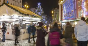 Christmas markets in front of a large decorated shopping center Palladium in Prague on the Republic square, 2017, 4k 4096p stock footage