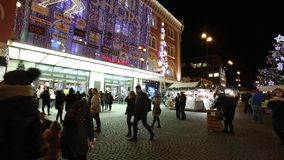 Christmas markets in front of a large decorated shopping center Palladium in Prague on the Republic square, 2017 stock footage