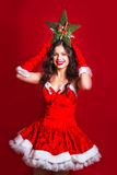 Christmas, x-mas, people, happiness concept - happy woman. Portrait of beautiful girl wearing santa claus clothes with Christ stock image
