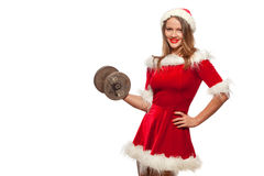 Christmas, x-mas, winter, happiness concept - Bodybuilding. Strong fit woman exercising with dumbbells in santa helper. Hat , isolated on White Background Stock Photos