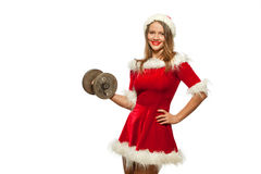 Christmas, x-mas, winter, happiness concept - Bodybuilding. Strong fit woman exercising with dumbbells in santa helper. Hat , isolated on White Background Royalty Free Stock Photo