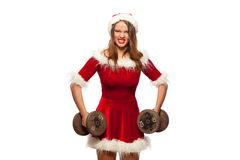 Christmas, x-mas, winter, happiness concept - Bodybuilding. Strong fit woman exercising with dumbbells in santa helper. Hat , isolated on White Background Stock Images
