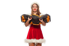 Christmas, x-mas, winter, happiness concept - Bodybuilding. Strong fit woman exercising with SANDBAG in santa helper hat. Isolated on White Background Royalty Free Stock Images
