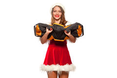 Christmas, x-mas, winter, happiness concept - Bodybuilding. Strong fit woman exercising with SANDBAG in santa helper hat. Isolated on White Background Royalty Free Stock Photos
