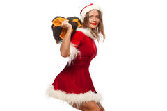 Christmas, x-mas, winter, happiness concept - Bodybuilding. Strong fit woman exercising with SANDBAG in santa helper hat. Isolated on White Background Stock Image