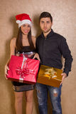 Christmas, x-mas, winter, valentine's day, birthday, couple, hap. Smiling women and men with gift boxes royalty free stock images