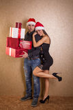 Christmas, x-mas, winter, valentine's day, birthday, couple, hap. Smiling women and men with gift boxes royalty free stock photos
