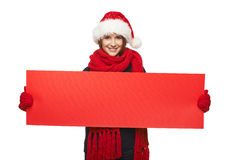 Christmas, X-mas, Xmas sale, shopping concept. Smiling woman wearing Santa hat with red sale sign - empty copy space for your text, looking at camera Stock Photos