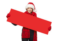 Christmas, X-mas, Xmas sale, shopping concept. Smiling woman wearing Santa hat with red sale sign, looking at blank copy space at banner Royalty Free Stock Photography