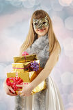 Christmas masquerade girl with cat mask Stock Images