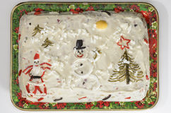 Christmas mayonnaise salad. Christmas traditional romanian mayonnaise salad ornate with Santa Claus, snowman and Christmas tree made of pickled vegetables and Royalty Free Stock Photos