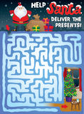 Christmas Maze for Kids. Help Santa find his way through the snowy maze to deliver the presents under the Christmas tree Stock Photo