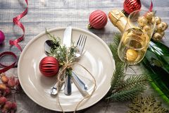 Christmas meal table setting design, flat lay. Royalty Free Stock Images