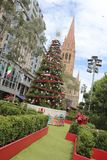 Christmas in Melbourne. Christmas decoration in Melbourne City Hall, Australia with St. Paul cathedral in background Stock Photo