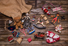Christmas memories in childhood: old and tin toys on wooden back. Christmas memories in childhood: old used and tin toys on wooden background for gifts stock photo