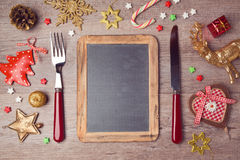 Christmas menu background with chalkboard and decorations. View from above Royalty Free Stock Image