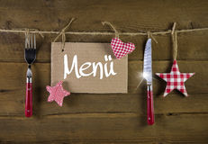 Christmas menu card for restaurants with knife and fork on woode Royalty Free Stock Image