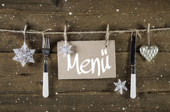 Christmas menu card for restaurants with knife and fork on wooden background.