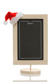 Christmas menu chalkboard. Empty restaurant menu chalkboard with santa claus hat on the conner isolated on white Royalty Free Stock Photography