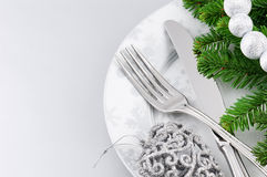 Christmas menu concept over silver background. Christmas menu concept with plate and cutlery over silver background Stock Photo