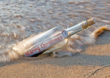 Christmas message in bottle Royalty Free Stock Photography