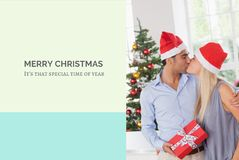 Christmas Message and Couple Kissing Design Royalty Free Stock Photos