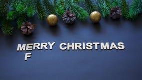 Letters spelling Merry Christmas , Frohe Weihnachten and Feliz Navidad stock video footage