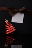 Christmas message on paper tag Royalty Free Stock Image