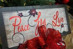 Christmas message on tree - closeup Stock Photos