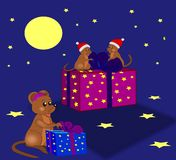 Christmas Mice. Three little mice that packs out Christmas gifts Royalty Free Stock Image