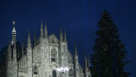 Christmas in Milan, Italy. The Duomo cathedral facade and a giant Christmas tree royalty free stock photography