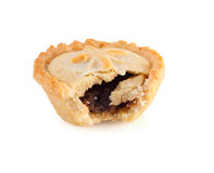 Christmas mince pie with a bite mark. On a white background royalty free stock photo