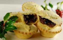 Christmas Mince Pies. Traditional Mince Pies for Christmas with a sprig of Holly royalty free stock image