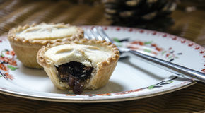 Christmas Mince Pies. On an old fashioned china plate Stock Photos