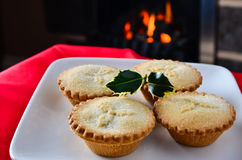 Christmas mince pies by the fire Stock Images