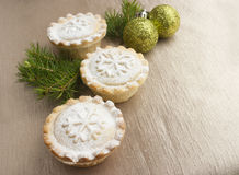 Christmas mince pies on golden background Royalty Free Stock Photos
