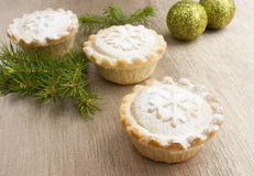 Christmas mince pies on golden background Stock Photo